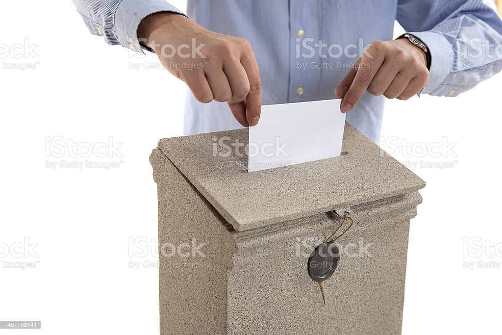 Man putting letter in mailbox royalty-free stock photo