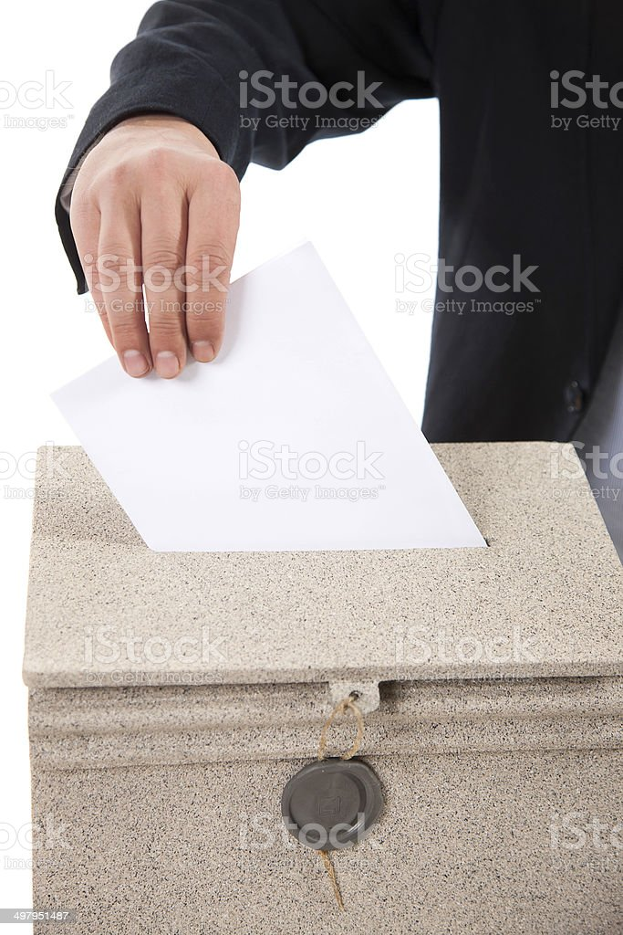 Man putting letter in mailbox stock photo
