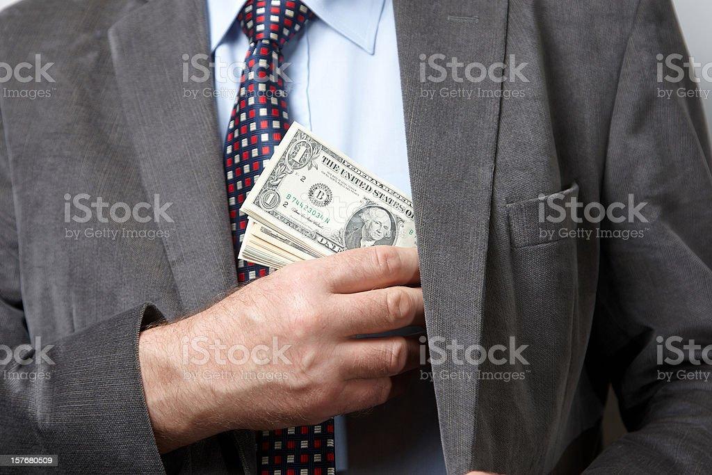 Man putting money in jacket inside pocket royalty-free stock photo