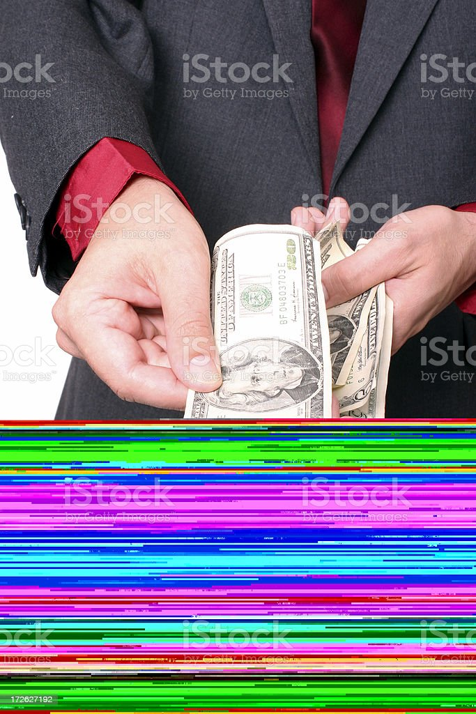 A man putting money into a colorful static-looking box royalty-free stock photo