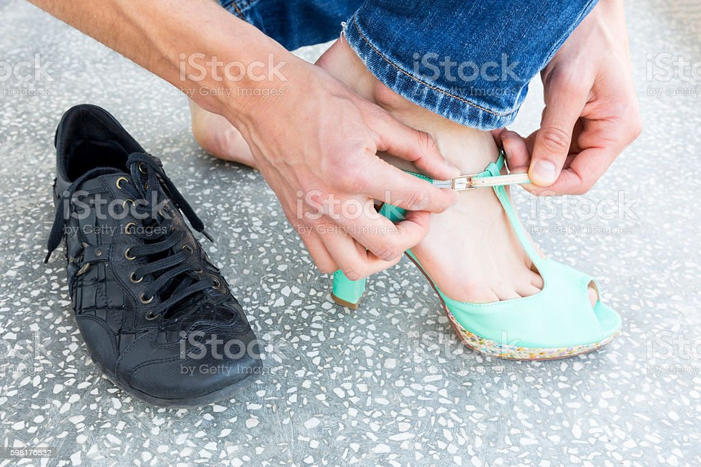Man putting on ladies shoes stock photo