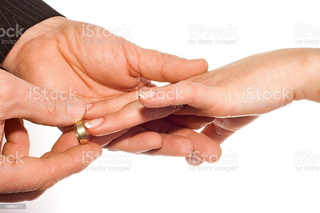 man putting wedding ring on bride's finger royalty-free stock photo