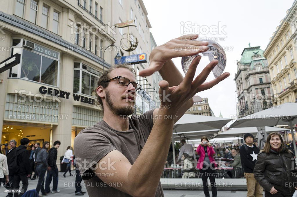 "Man ""Playing"" with Crystal Ball Vienna Austria royalty-free stock photo"