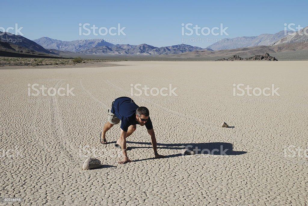 Man Racing Sliding Rocks royalty-free stock photo