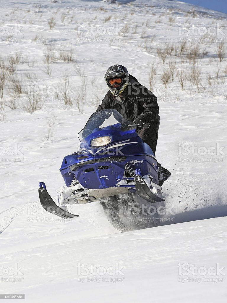 man racing snowmobile royalty-free stock photo