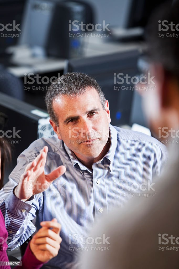 Man raising hand to ask question stock photo