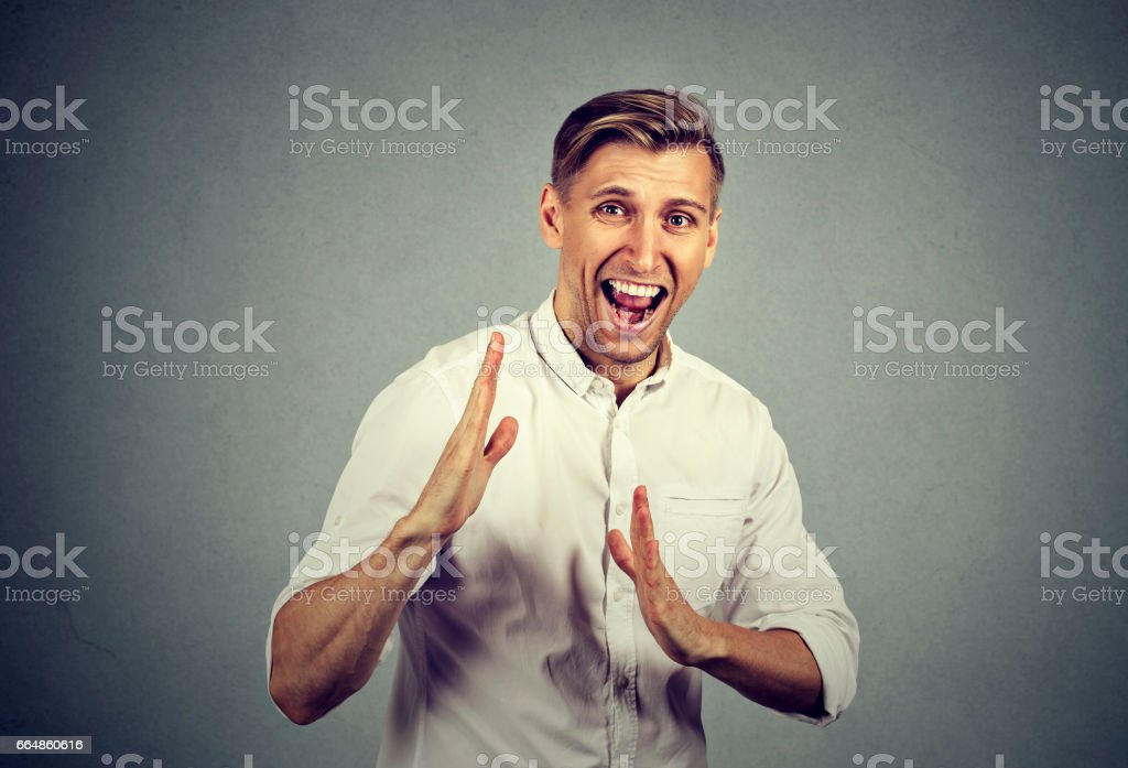 man raising hands in  air attack with karate chop stock photo