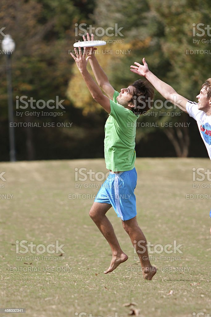 Man Reaches to Catch Disc In Ultimate Frisbee Game royalty-free stock photo