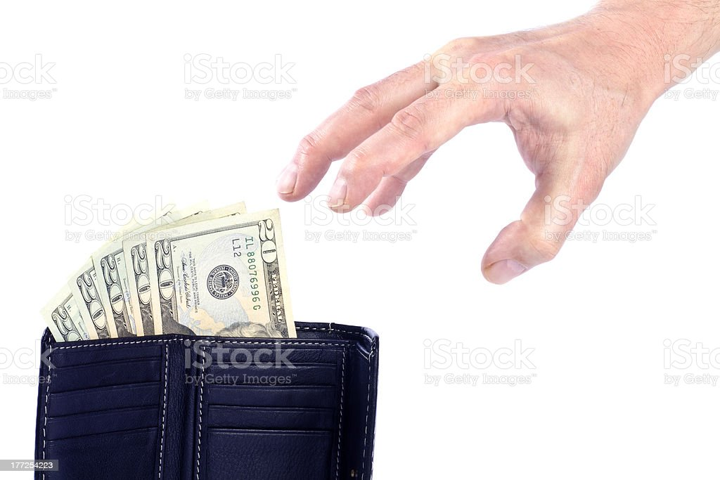 Man Reaching for Money in a Wallet royalty-free stock photo