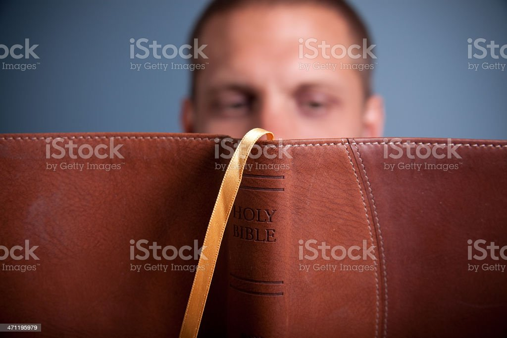 Man reading a bible stock photo
