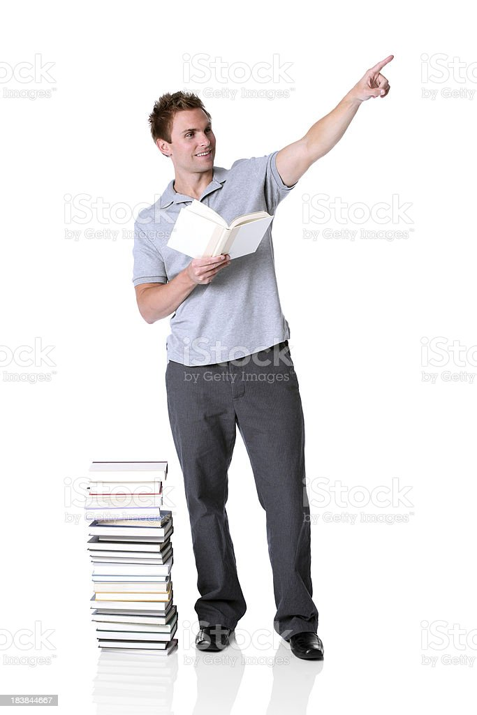 Man reading a book and pointing away royalty-free stock photo