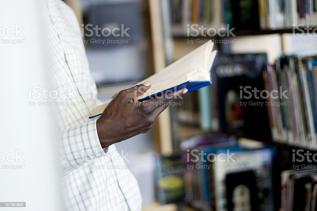 Man Reading a Book at the Library stock photo