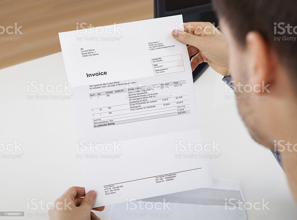 Man reading a invoice document royalty-free stock photo