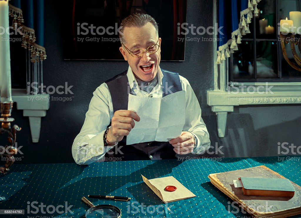 Man reading a letter stock photo