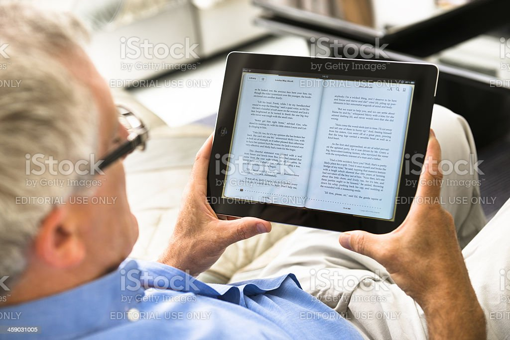 Man reading an ebook with Ipad royalty-free stock photo