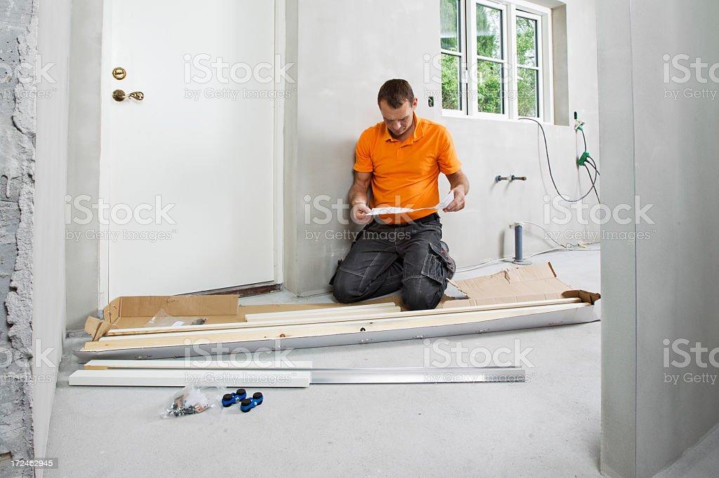 Man reading assemply plan royalty-free stock photo