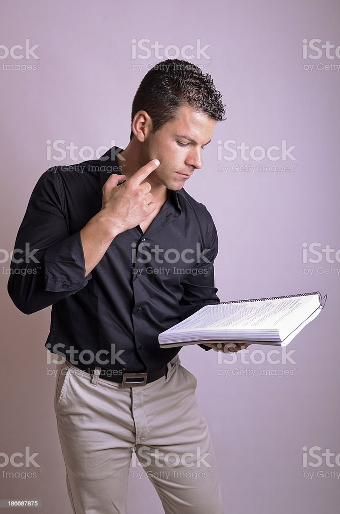 Man reading book, actor or student. stock photo