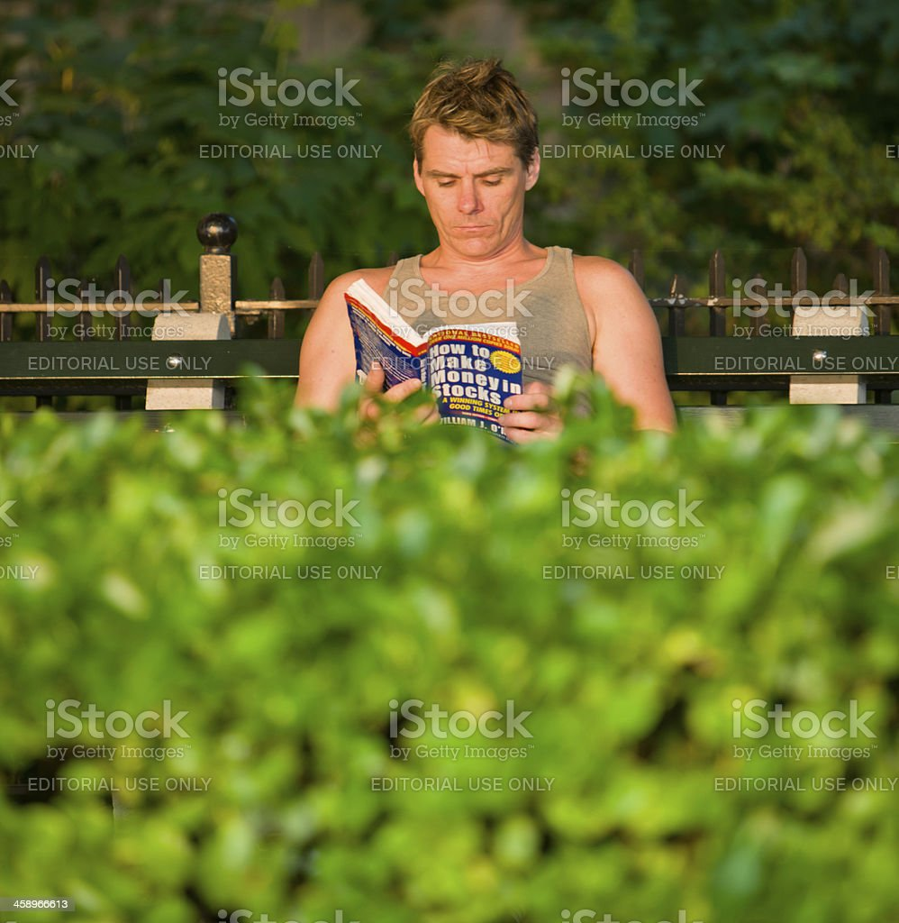 Man Reading Book in park, New York royalty-free stock photo