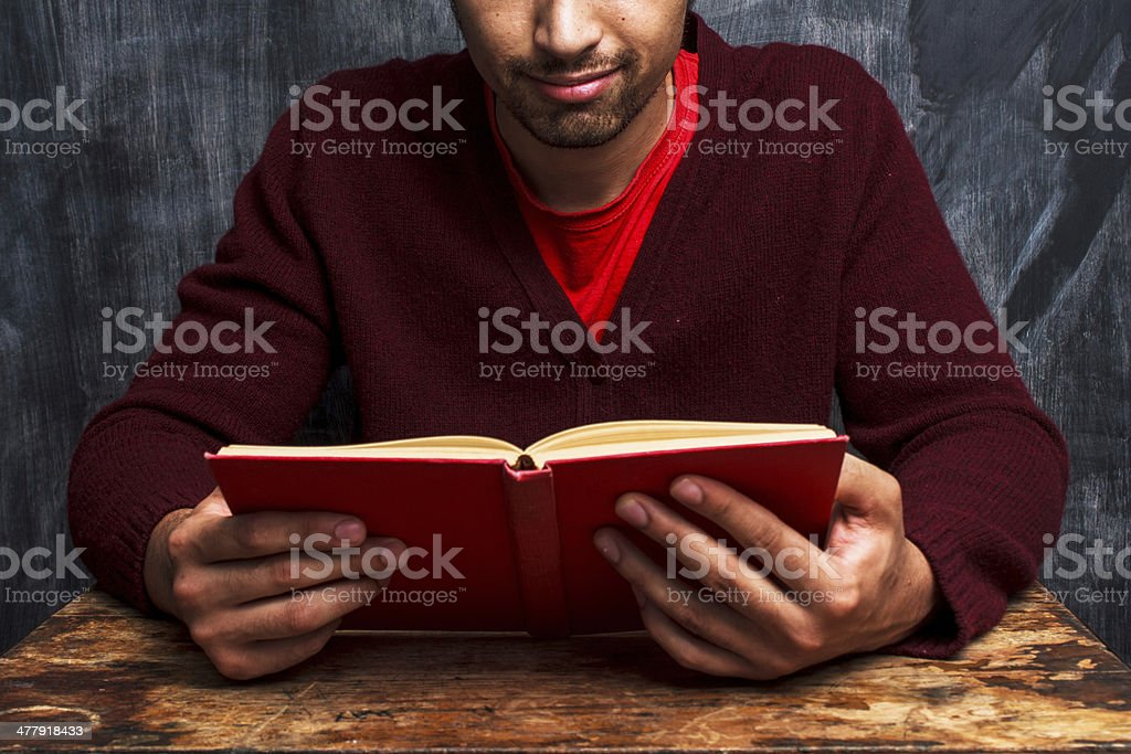 Man reading in front of blackboard royalty-free stock photo