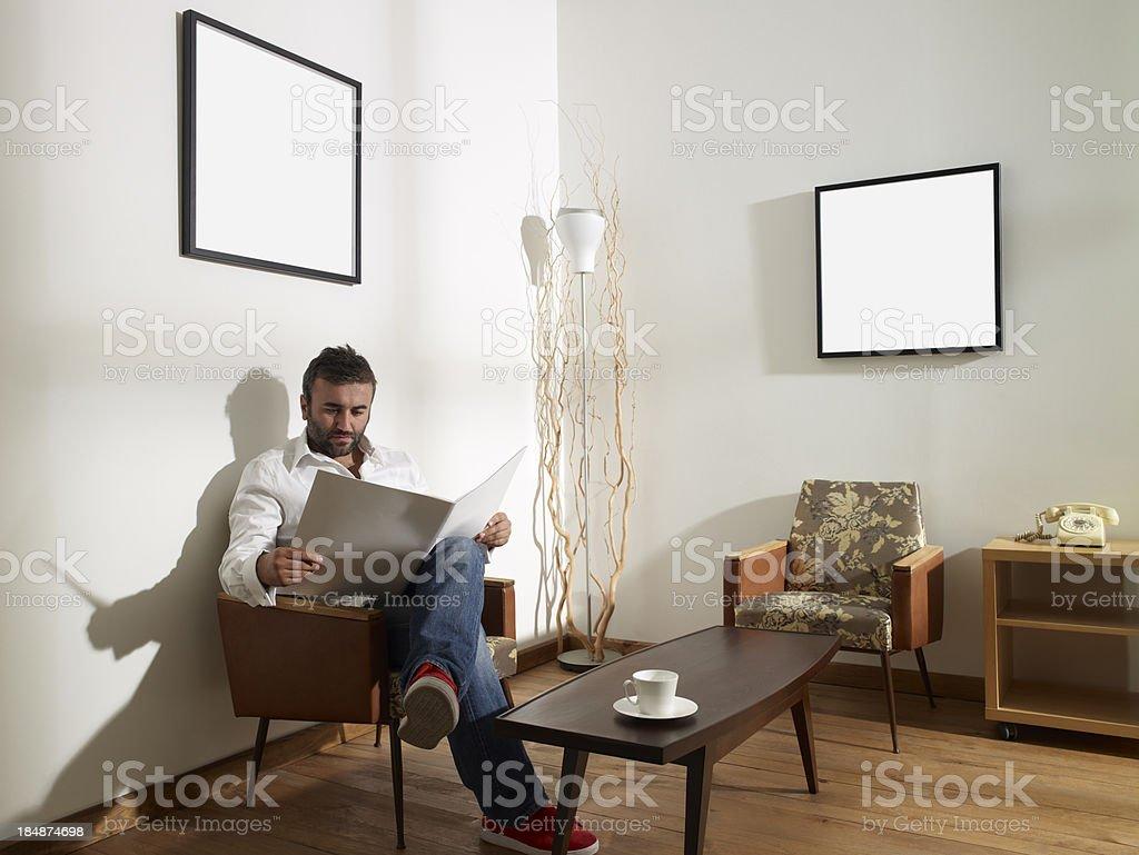 Man reading magazine royalty-free stock photo