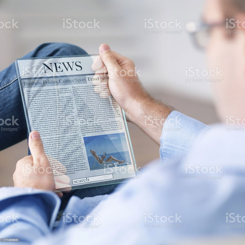 man reading news on the futuristic digital tablet royalty-free stock photo