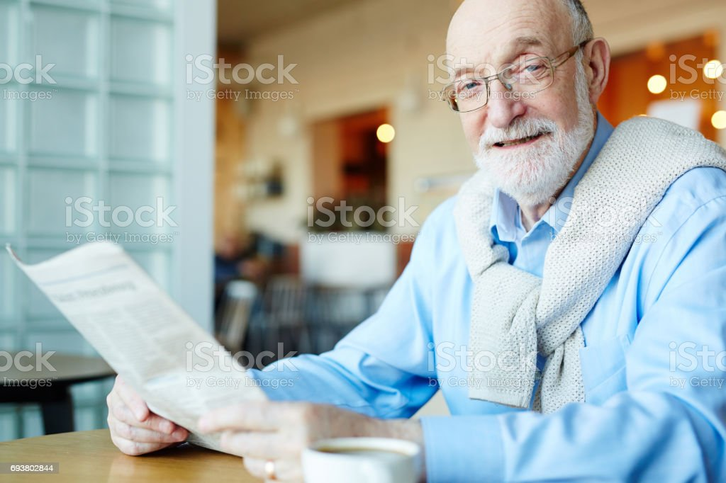 Man reading news stock photo