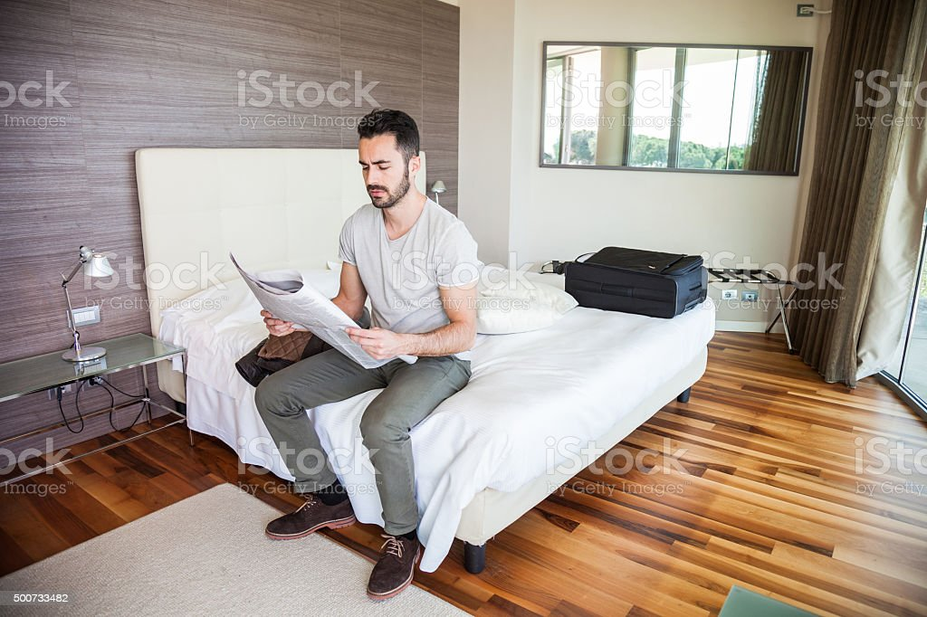Man reading newspaper in the morning stock photo