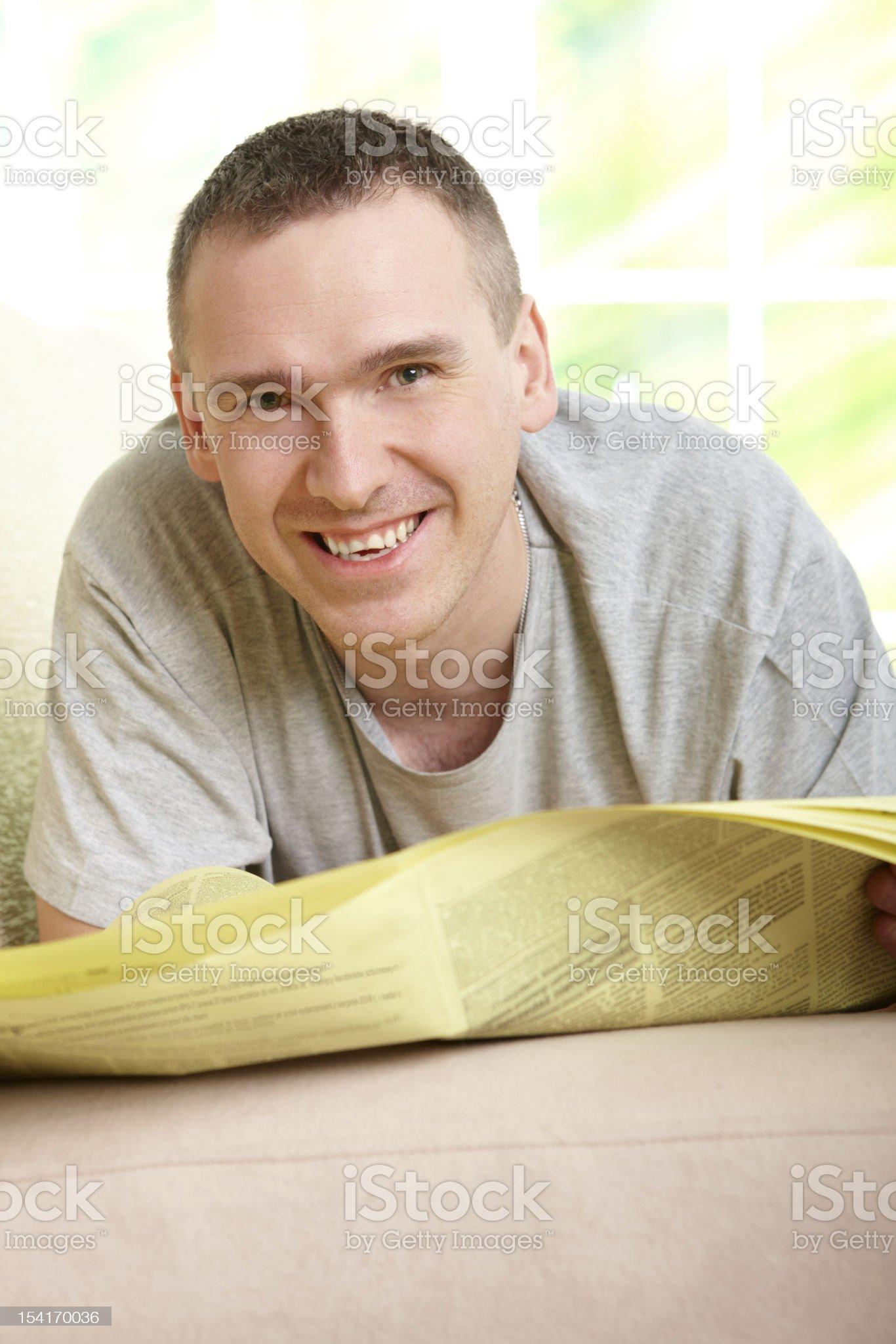 Man reading newspaper royalty-free stock photo