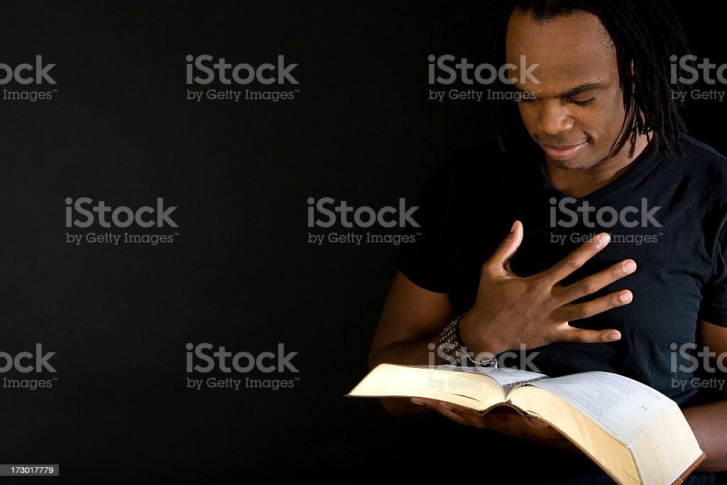Man reading the bible stock photo