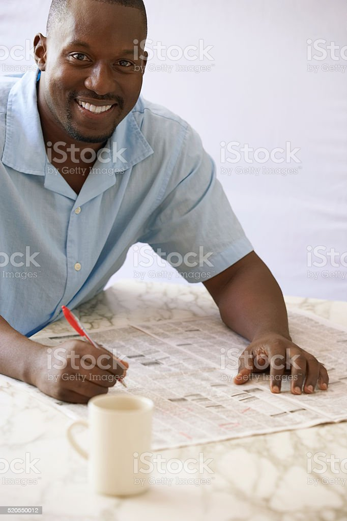Man reading the classified ads stock photo