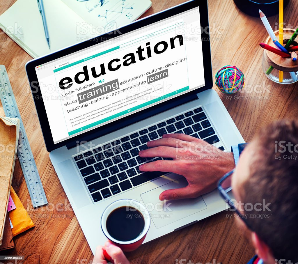 Man Reading the Definition of Education stock photo