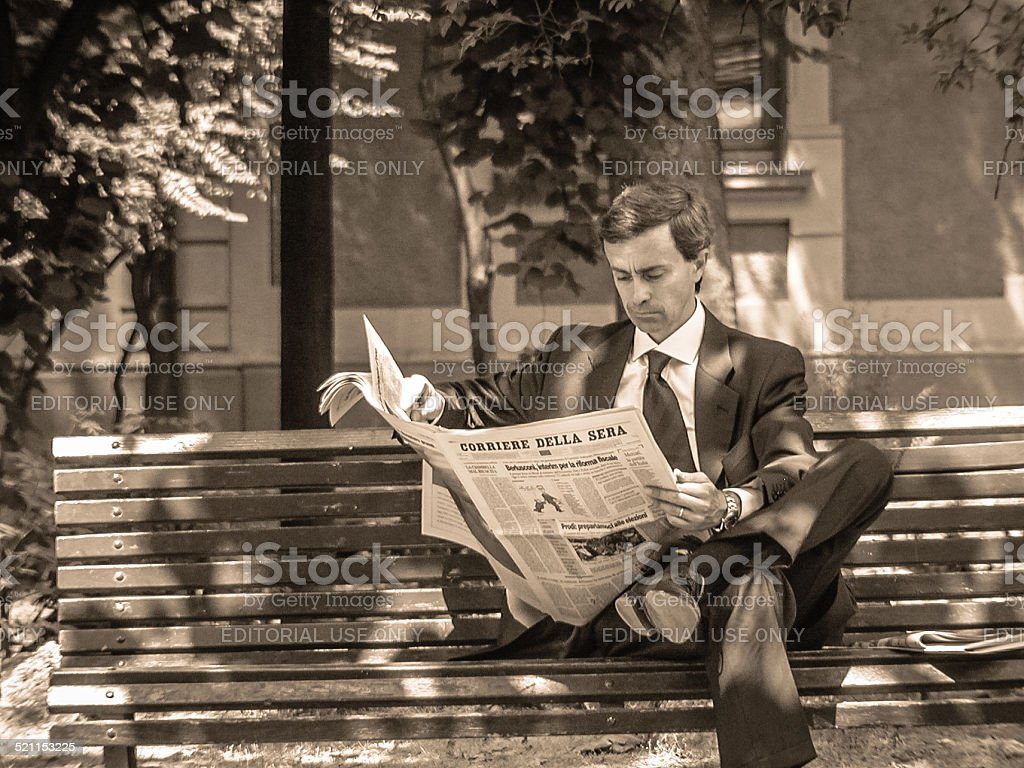 Man reading the newspaper stock photo