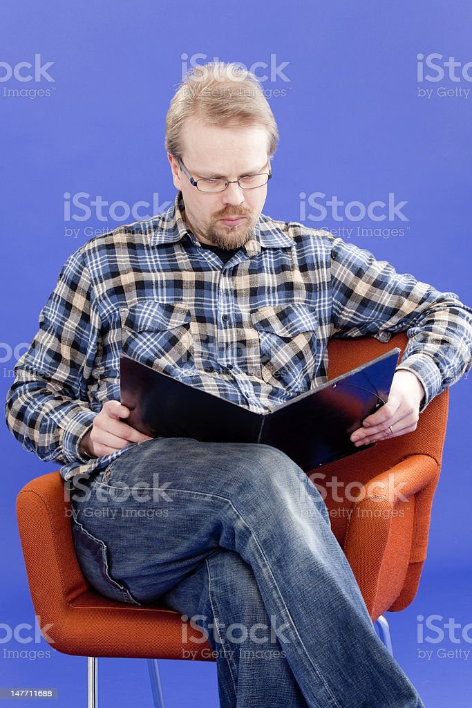 Man reads business papers royalty-free stock photo
