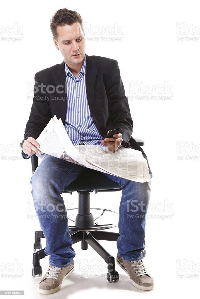 man reads newspaper phoning - economy news royalty-free stock photo
