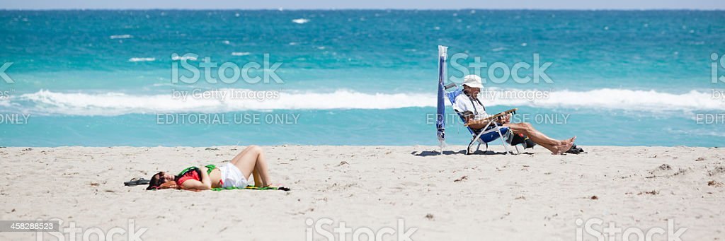 Man reads the book on a beach royalty-free stock photo
