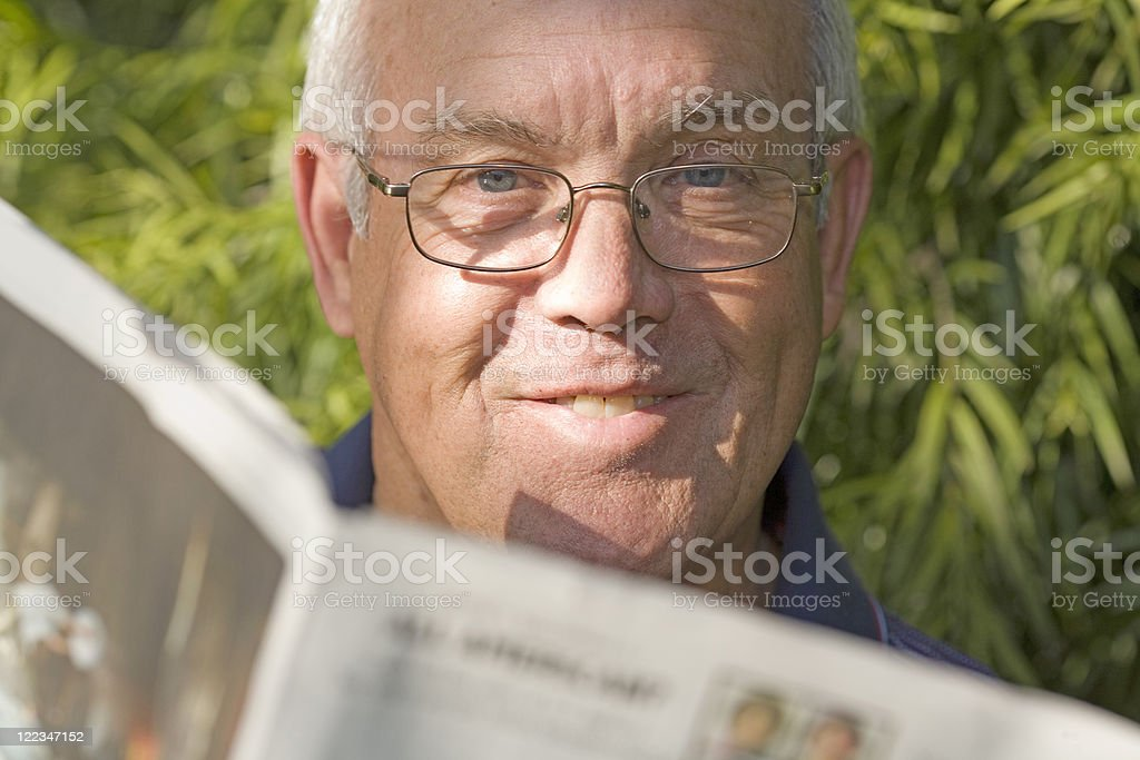 Man reads the newspaper royalty-free stock photo