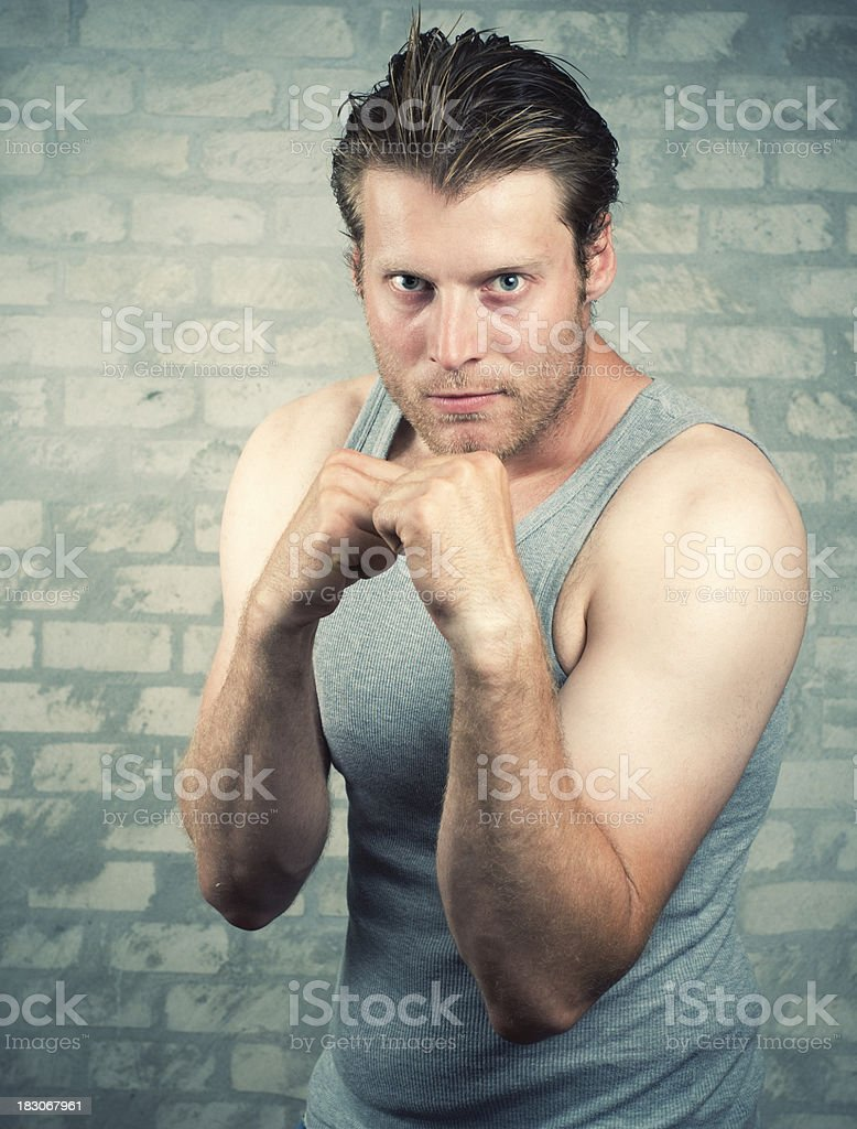 Man ready for fist fight and getting ready to hit stock photo