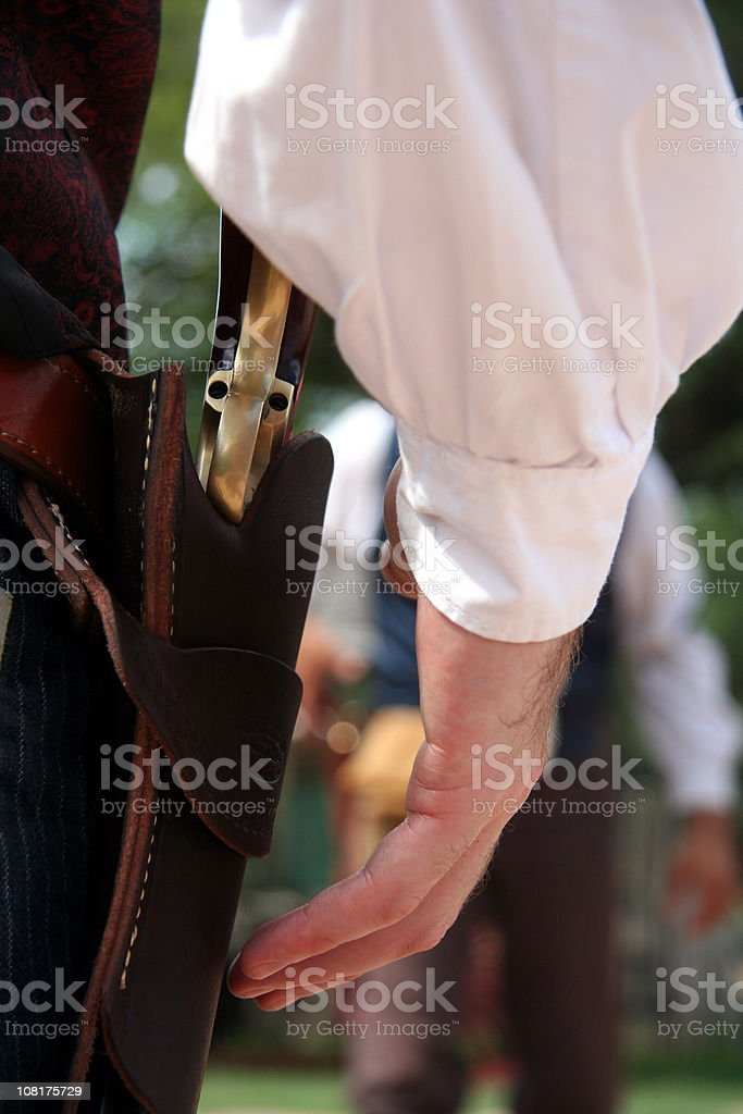 Man Ready to Draw Gun in Wild West Shoot Out stock photo