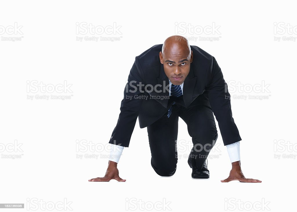 Man ready to race in business against white - copyspace royalty-free stock photo