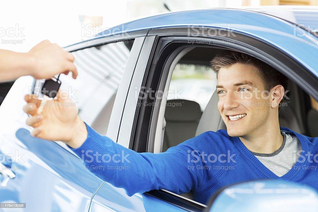 Man Receiving Car Key stock photo
