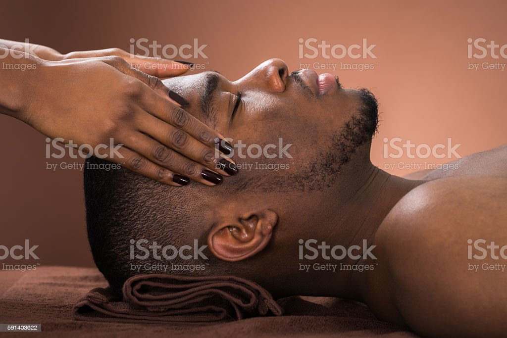 Man Receiving Forehead Massage stock photo
