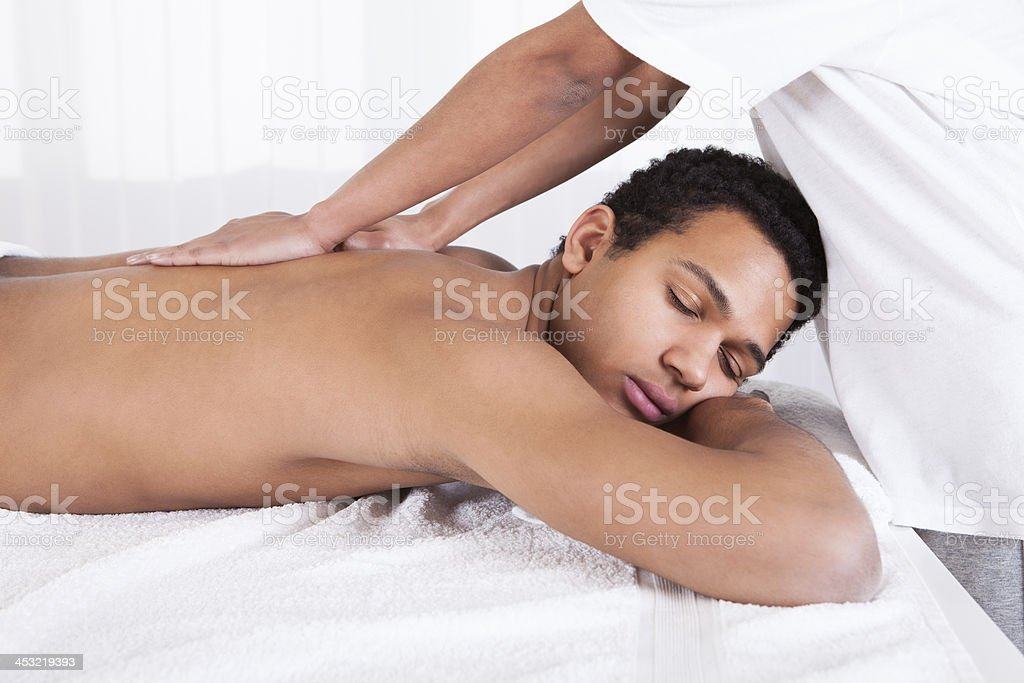 Man Receiving Massage From Female Hand royalty-free stock photo