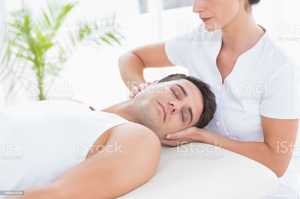 Man receiving neck massage stock photo