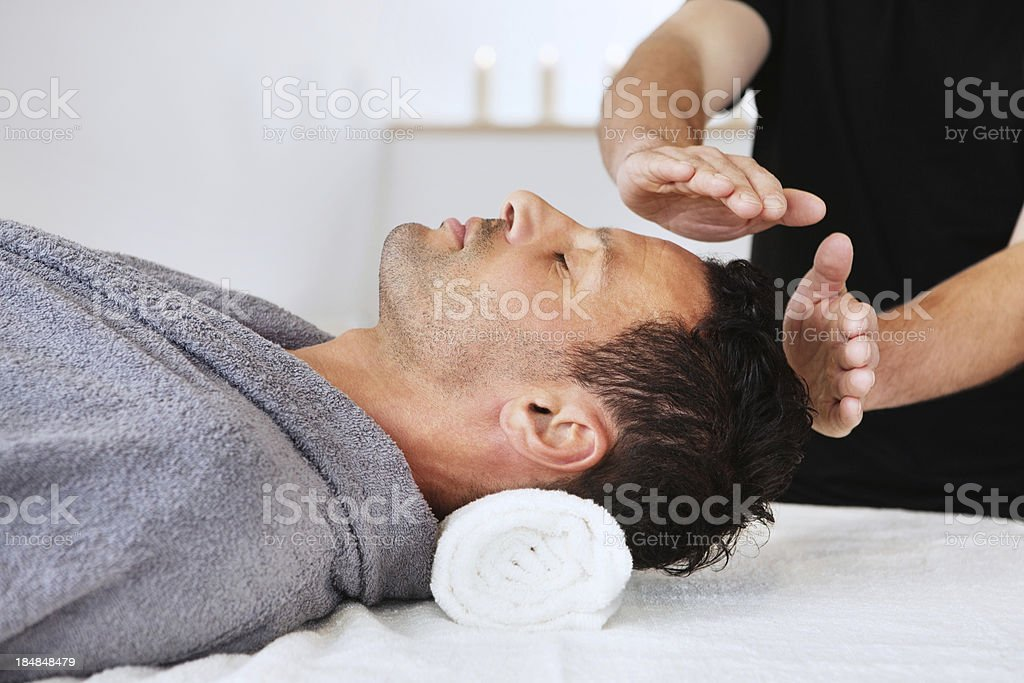 Man Receiving New Age Therapy stock photo
