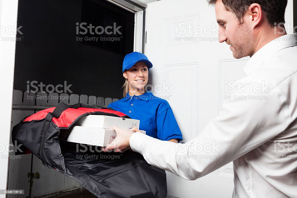 Man Receiving Pizza from a Delivery Girl stock photo