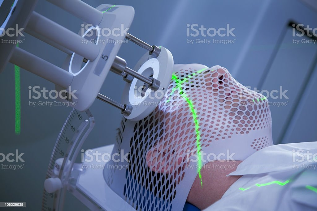 Man Receiving Radiation Therapy for Cancer stock photo