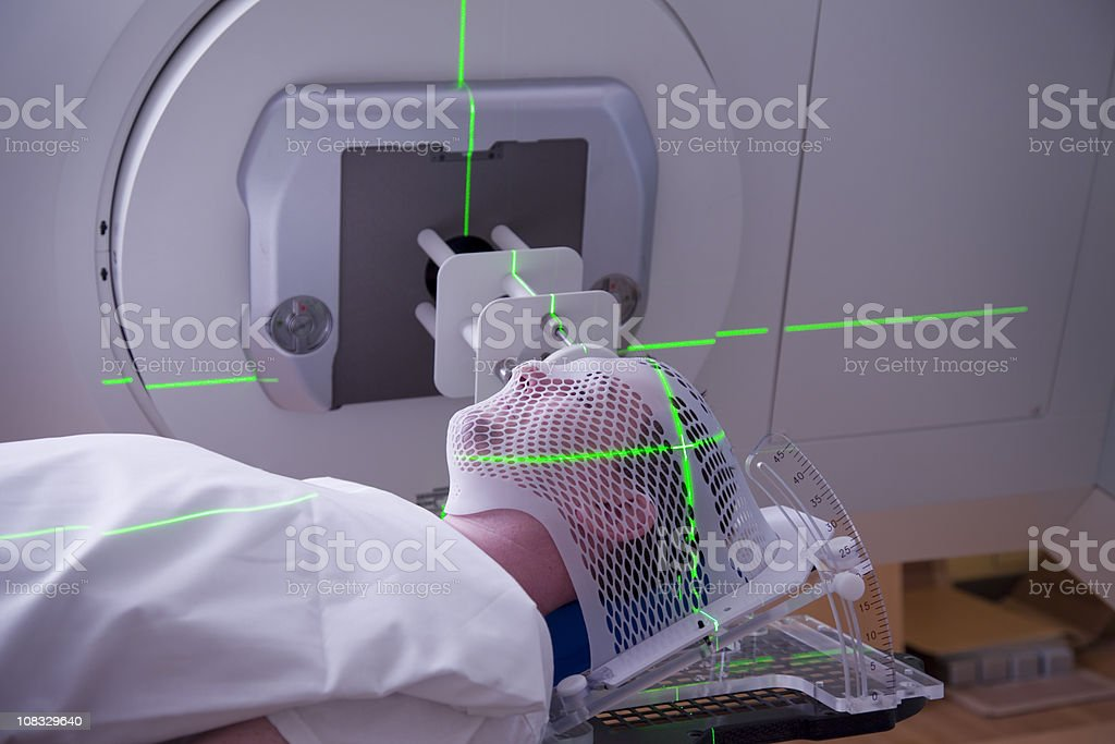 Man Receiving Radiation Therapy for Cancer Treatment. stock photo