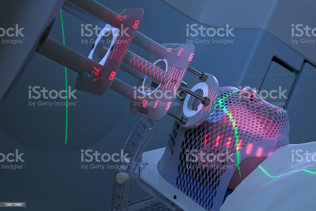 Man Receiving Radiotherapy for Cancer Treatment stock photo