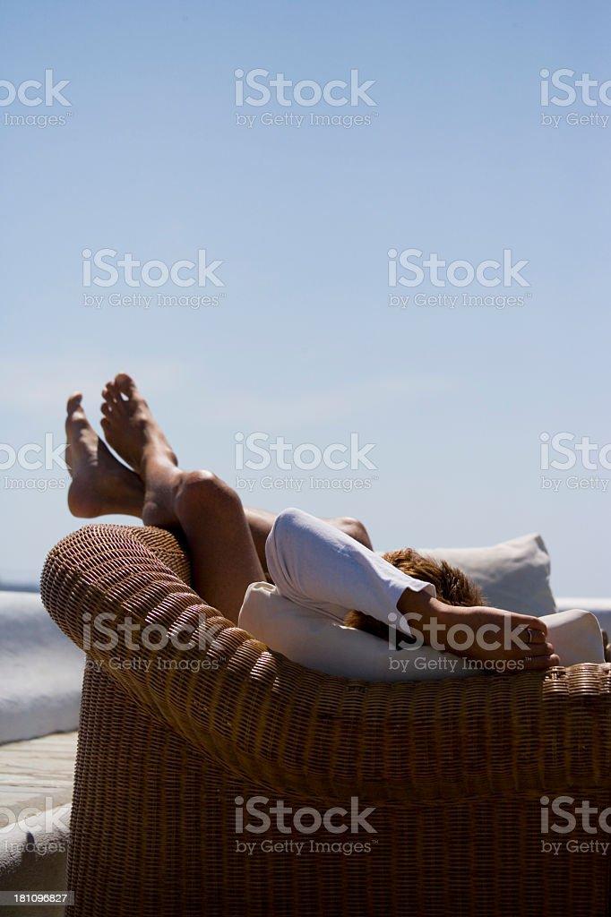 Man reclining stock photo