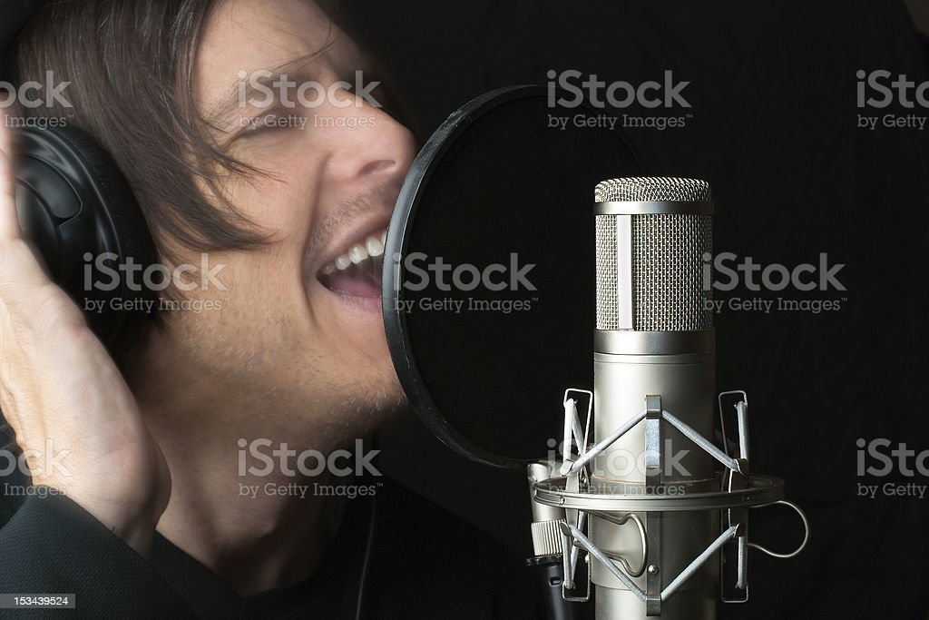 Man Records Vocals In Studio royalty-free stock photo